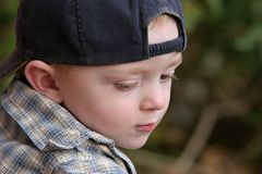 Pensive child. Portrait of a cute young boy wearing a baseball cap Stock Images