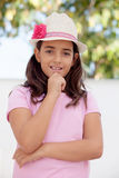 Pensive child girl ten year old with a hat Royalty Free Stock Images