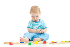 Pensive child playing logical educational toys Stock Photography