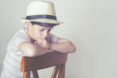 Pensive child. Sad and pensive child with hat Royalty Free Stock Photos