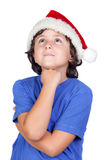 Pensive child with Santa hat Royalty Free Stock Image