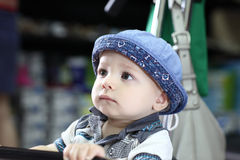Pensive child in store Stock Image