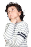 Pensive child with striped sweater Royalty Free Stock Image