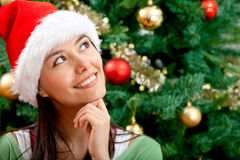 Pensive Christmas woman Stock Photography