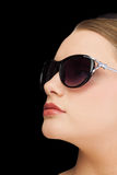 Pensive classy blonde wearing sunglasses Stock Images