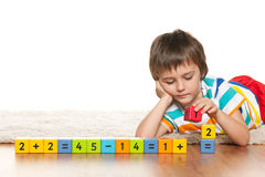 Pensive clever boy with blocks Stock Photo