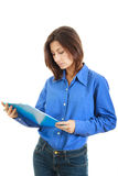 Pensive college girl or woman with  textbook Royalty Free Stock Photo