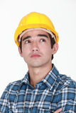 Pensive construction worker Stock Photo