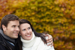 Pensive couple in autumn thinking Royalty Free Stock Photos