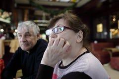 Pensive couple in restaurant Stock Image