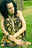 Pensive curly woman Royalty Free Stock Image