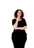 Pensive curvy girl with black dress Royalty Free Stock Image