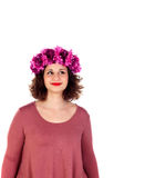 Pensive curvy girl with a flowered headdress Royalty Free Stock Photos