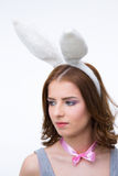 Pensive cute woman in rabbit ears looking away Stock Photos