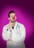 Pensive doctor with a clown nose Stock Images