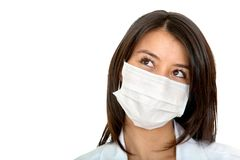 Pensive doctor with facemask Stock Images