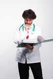 Pensive doctor with files Royalty Free Stock Photos