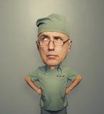 Pensive doctor in glasses Stock Image