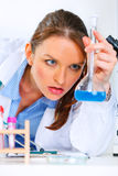 Pensive doctor woman analyzing results of test Stock Image