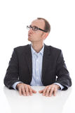 Pensive and doubtful isolated businessman looking at the side we Stock Images