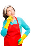 Pensive and dreamy housewife with sponge Stock Image