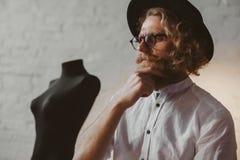 Pensive dressmaker in atelier royalty free stock images