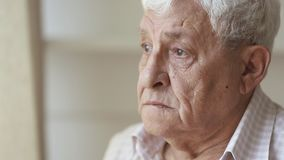 Pensive sad elder senior man looking away feel upset