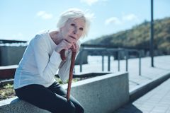 Pensive elderly lady looking into sky royalty free stock photo