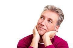 Pensive elderly man Stock Image