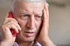 Old man call Stock Image