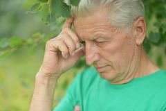 Pensive elderly man Stock Images