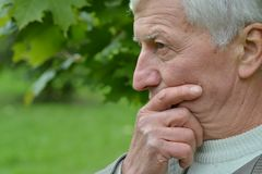 Pensive elderly man Royalty Free Stock Images