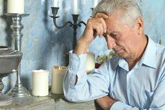 Pensive elderly man Stock Photos