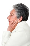 Pensive elderly woman Stock Images