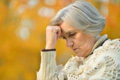 Pensive elderly woman Royalty Free Stock Image