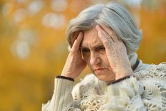 Pensive elderly woman Royalty Free Stock Image