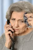 Pensive elderly woman Royalty Free Stock Photography