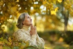 Pensive elderly woman Stock Photo