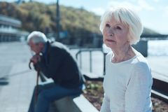 Pensive elderly woman dreaming outdoors Royalty Free Stock Photos