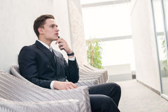 Pensive employee. Confident businessman thinking about business Royalty Free Stock Photography