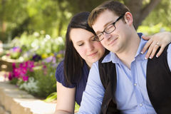 Pensive Engaged Couple Relaxing in the Park Stock Image