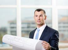 Pensive engineer hands blueprint Stock Photos