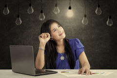 Pensive entrepreneur looking bright lamp Royalty Free Stock Photography