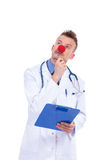 Pensive fake clown doctor with red nose Royalty Free Stock Photo