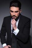 Pensive fashion man looks down Royalty Free Stock Photo