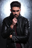 Pensive fashion young man in leather jacket Stock Images