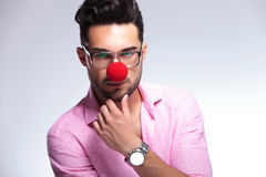 Pensive fashion young man with red nose Stock Image