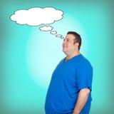Pensive fat men with a black bubble. Pensive fat man with a black bubble on a green background Stock Photo