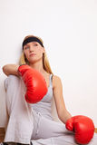Pensive female boxer Royalty Free Stock Images