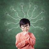 Pensive female child thinking idea Stock Images
